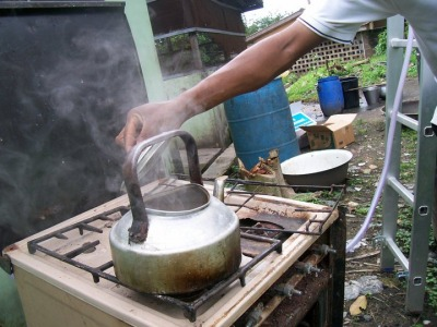 Trying the biogas cookstove at Sacred Heart Hospital
